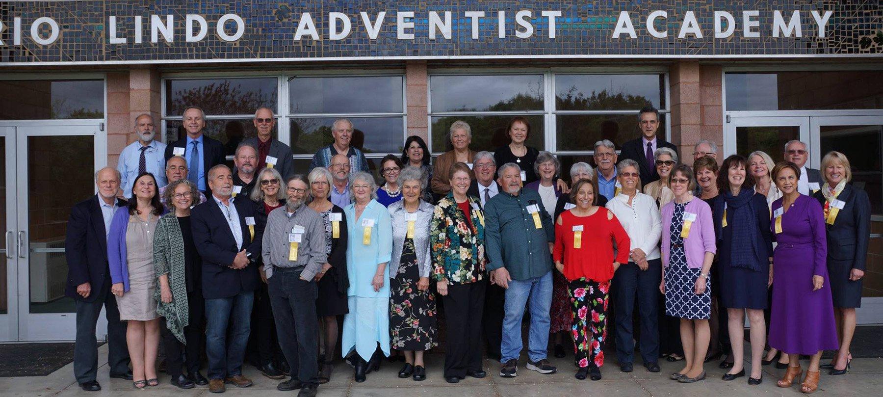 50 year alumni class smiles at camera