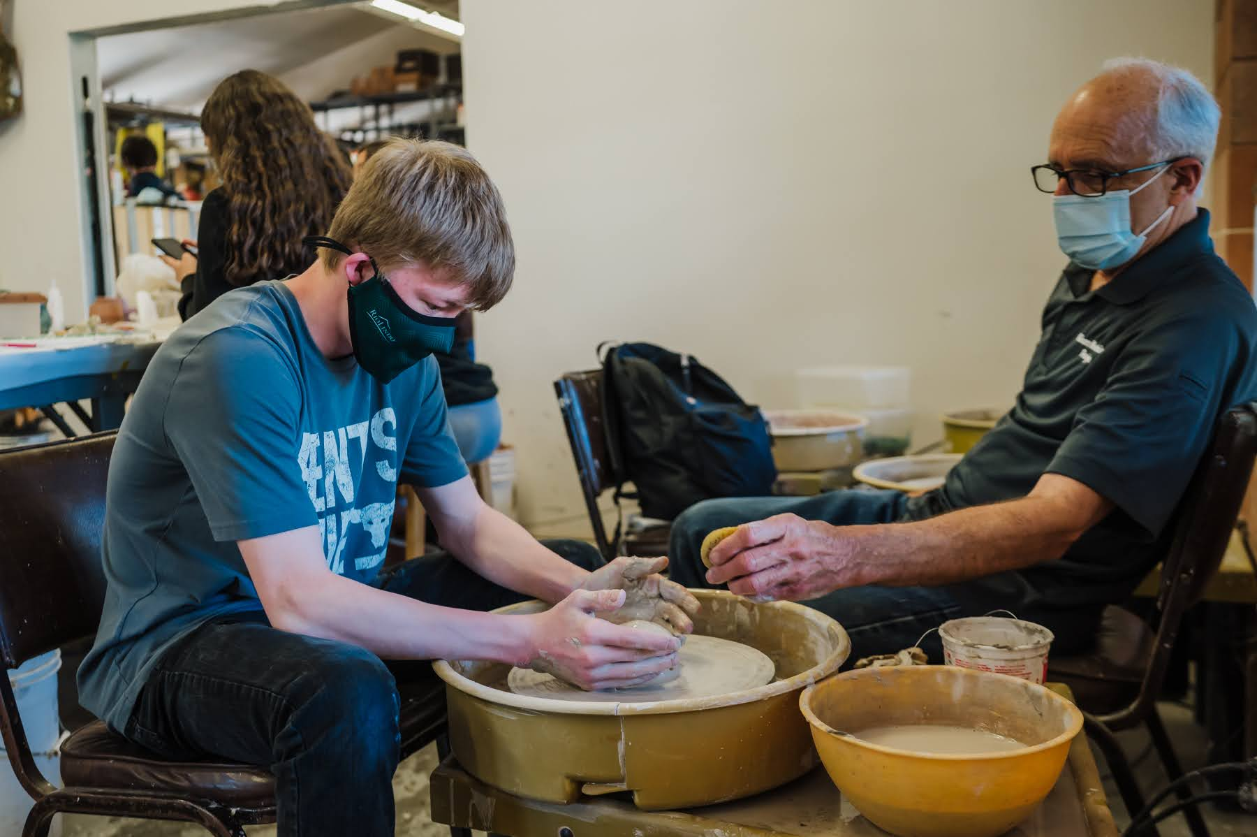 student creates ceramics on pottery wheel