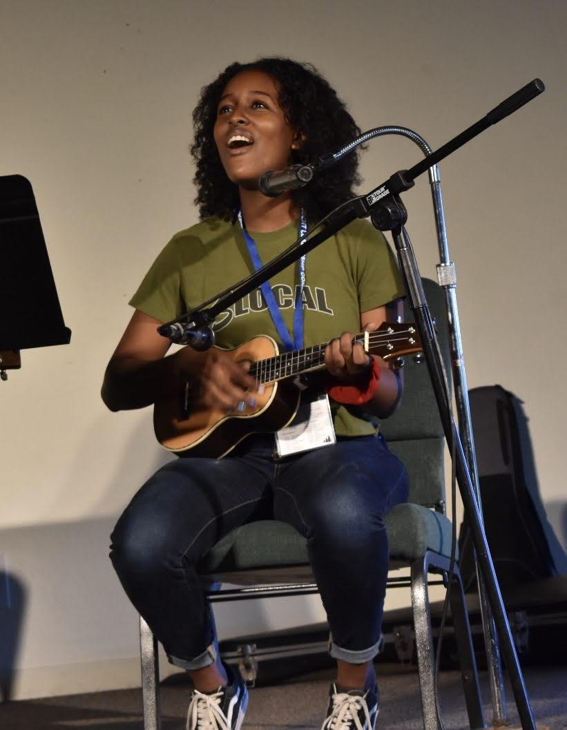 student plays ukelele