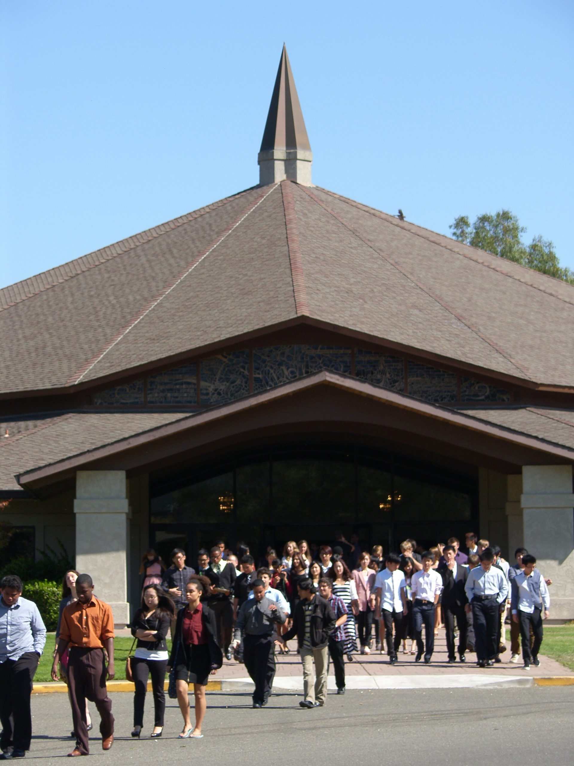 students walk out of church